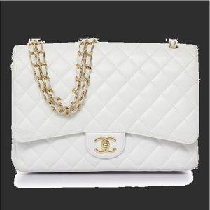 Pristine preowned Chanel Caviar Maxi Double flap
